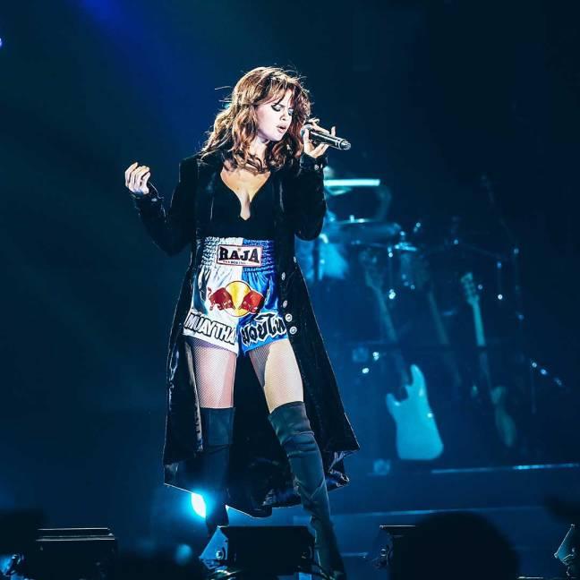 Selena Gomez wearing Raja Muay Thai shorts while performing